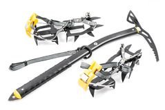Climbing gear on a white background. Climbing gear: an ice axe and crampons Royalty Free Stock Image