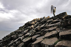 Climbing Giant's Causeway stones Royalty Free Stock Photos