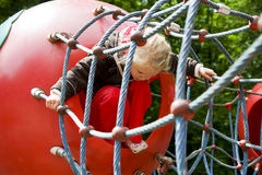 Climbing girl at the playground Royalty Free Stock Images