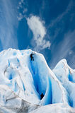 Climbing a glacier in patagonia. Two men climbing a glacier in patagonia Royalty Free Stock Photography