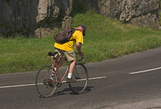 Climbing the Gorge. Man on old road bike climbing Cheddar Gorge stock photography