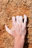 Climbing hand grip on rock. Male hand with chalk powder on rocks Royalty Free Stock Images