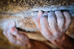 Climbing hands. Crimping a hold on a boulder problem, Hampi, India Royalty Free Stock Photos