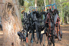 Climbing harnesses and rope - ready for fun!. Climbing harnesses handing from a rope - used for a rope course Stock Photos