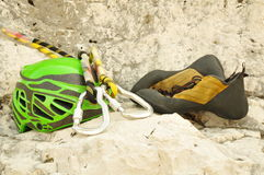 Climbing helmet, carabiner and shoes Royalty Free Stock Photography