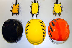 Climbing helmets and crampons on a gray background in a flat lay Royalty Free Stock Photography