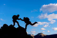 Climbing help. Crazy adventurous and climber.Discovery and adventure royalty free stock photo