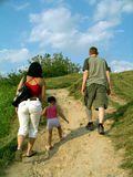 Climbing the hill. The family of three climbing a hill Stock Image