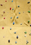 Climbing holds on an artificial climbing wall Royalty Free Stock Photo