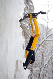 Climbing ice ax in the white ice. Fall Royalty Free Stock Photo