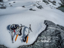 Climbing Ice Picks and Helmet. In the Snow Stock Photo