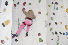 Climbing on indoor wall Stock Image