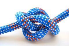 Climbing knot. Alpine knot,blue climbing rope,Bowline knot Royalty Free Stock Photos