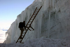 Climbing a ladder. Over an ice wall. Climbing Cotopaxi (highest volkano in the world, 5.897 m), Ecuador royalty free stock images