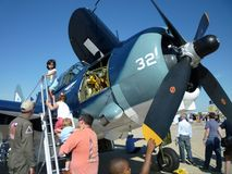 Climbing the Ladder to See the WWII Helldiver Stock Images