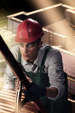 Climbing a ladder. Worker on the background of the site climbs the ladder Royalty Free Stock Images