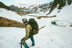 Climbing Man with big backpack and ice axe mountaineering Stock Images