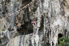 Climbing man woman  thailand TonSai beach cliff rock extreme sports. Free climbers on the cliff Stock Photos