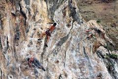 Climbing man woman  thailand TonSai beach cliff rock extreme sports Stock Images