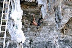 Climbing man woman  thailand TonSai beach cliff rock extreme sports Royalty Free Stock Image