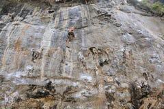 Climbing man woman  thailand TonSai beach cliff rock extreme sports Royalty Free Stock Photo
