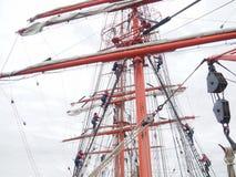 Climbing the mast on old tallship or sailboat Stock Image