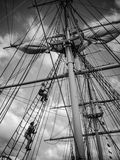 CLimbing the masts. Men climbing the masts getting ready to set sail stock image