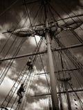 Climbing masts. Men climbing masts on Large schooner Stock Photography