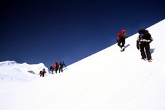 Climbing Mera Peak. Trekkers climbing from the Mera La, in the Himalayas on their way to summit Mera Peak Stock Images