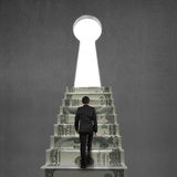 Climbing on money stairs to key hole Royalty Free Stock Images