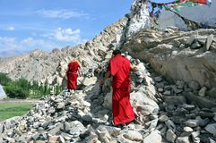 Climbing monks Stock Images