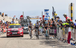 Climbing Mont Ventoux. Mont Ventoux, France- July 14 2013:Group of three cyclists, the French cyclist Romain Bardet (Ag2r-La Mondiale Team),the Polish cyclist Royalty Free Stock Images