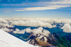 Climbing Mount Elbrus. Stunning views of the vast sky and the world to the bottom of Mount Elbrus stock image