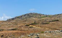 Climbing the mountain in Arikok Park. Stock Photos