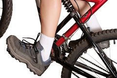 Climbing on mountain bike Royalty Free Stock Image