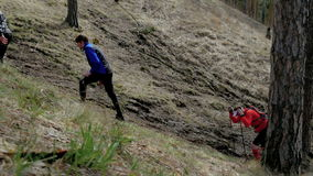 Climbing mountain on foot athletes group of runners stock video