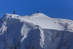 Climbing on mountain in winter Stock Images