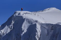 Climbing on mountain in winter Stock Photo