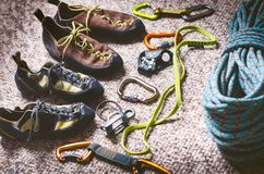 Climbing and mountaineering equipment on a carpet. Shoes, carbine, rope, lope, ascend-er. Concept of outdoor and extreme sport. Royalty Free Stock Images