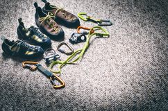 Climbing and mountaineering equipment on a carpet. Shoes, carbine, rope, lope, ascend-er. Concept of outdoor and extreme sport. Royalty Free Stock Photo