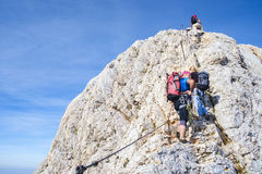 Climbing  mt Triglav, Julian alps. Triglav, Slovenia - 09,03,2016: Climbers progressing on the climb to the top of Mt Triglav Stock Photos