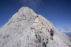 Climbing Mt Triglav. Man climbing Mt Triglav, Julian Alps Royalty Free Stock Photos
