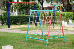 Climbing net and chain swing at playground. Stock Photography