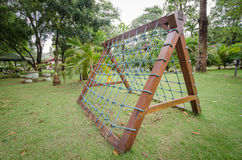 Climbing net with wooden frame. Royalty Free Stock Photo