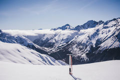 Climbing New Zealand avalanche peak with ice axe Stock Images