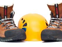 Climbing orange helmet and boots Stock Photography
