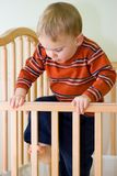 Climbing out of crib Royalty Free Stock Photos
