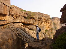 Climbing over cliffs in dogon. Climbing on wooden leatters over cliffes in mali Royalty Free Stock Photo
