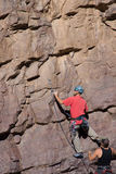 Climbing pair and wall Stock Images