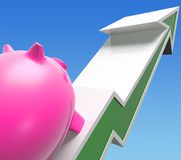 Climbing Piggy Shows Growing Investment Or Savings Stock Photos